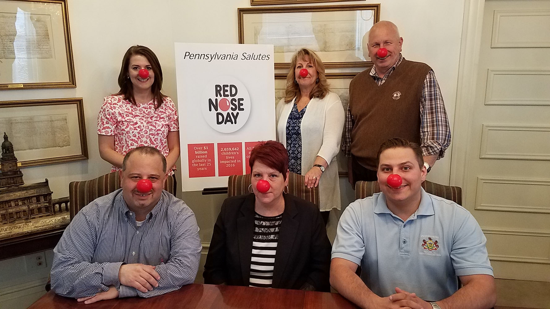 Malady & Wooten team members wearing red noses for Walgreens Red Nose Day 2017