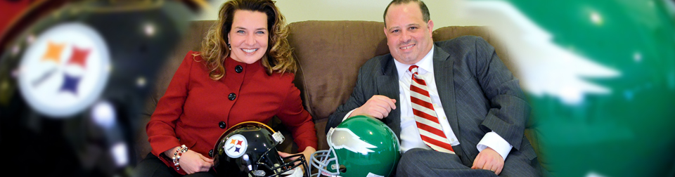 Jodie Stuck & Dennis Giorno with Steelers & Eagles helmets